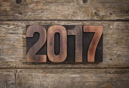 letterpress blocks: 2017, year set with vintage letterpress printing blocks on rustic wooden background