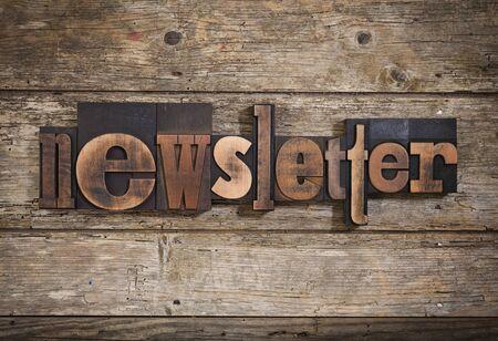 letterpress blocks: newsletter, single word set with vintage letterpress printing blocks on rustic wooden background