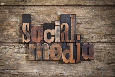 letterpress blocks: social media, phrase set with vintage letterpress printing blocks on rustic wooden background
