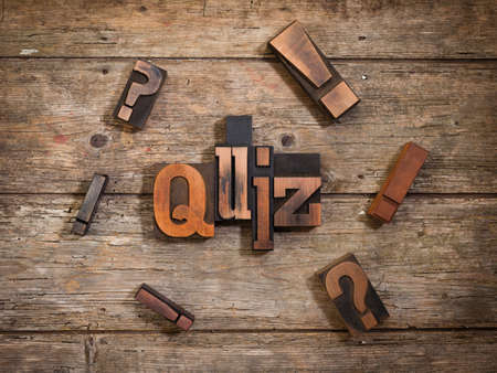 trivia: quiz, single word set with vintage letterpress printing blocks on rustic wooden background, surrounded by exclamation and question marks Stock Photo