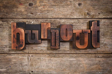 letterpress blocks: burnout, single word set with vintage letterpress printing blocks on rustic wooden background