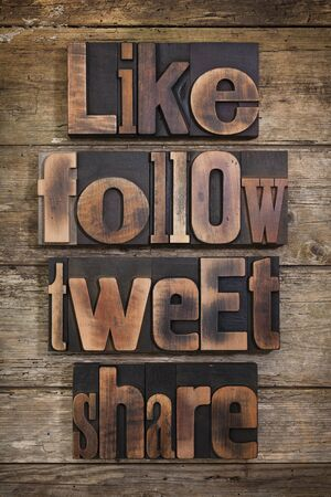 tweet: like, share, tweet, follow, social media tags set with antique letterpress type on rustic wooden background