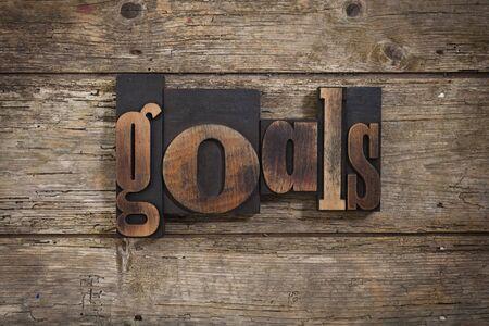 letterpress blocks: goals, single word set with vintage letterpress printing blocks on rustic wooden background