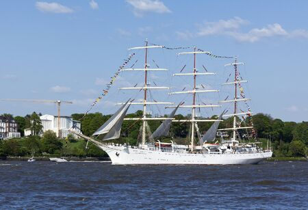 Polish tall ship Dar Mlodziezy on the Elbe river during the departure parade of 827th Hamburg Port Anniversary