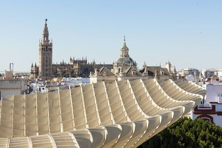 metropol parasol: Seville Cathedral and Church of Annunciation  with Metropol Parasol structure in foreground Stock Photo