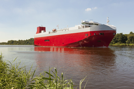 car carrier: Huge car carrier on Kiel Canal heading to the baltic sea