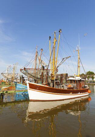 shrimp boat: Shrimpers moored at the harbor of Fedderwardersiel on teh GErman North Sea coast Stock Photo