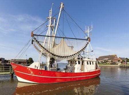 shrimp boat: Shrimp boat at the harbor of Fedderwardersiel at the North Sea coast