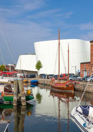 Stralsund, Germany - September 23, 2016: Marina and back side of Ozeaneum aquarium at Stralsund.
