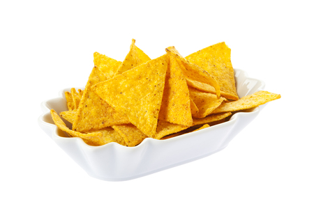 tortilla chips: Bowl filled with tortilla chips isolated on white background