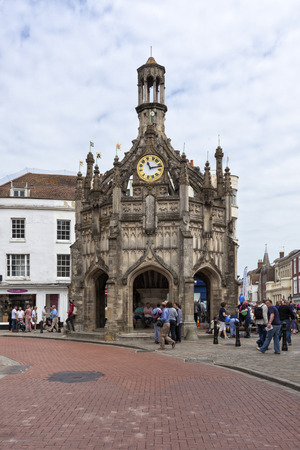 west sussex: Chichester, Great Britain - May 17, 2014: Chichester Cross, a p erpendicular market cross in the centre of the city of Chichester, West Sussex. Several people sitting and standing inside and nearby, some passing by.