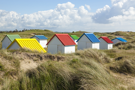 normandy: Colorful beach huts in the dunes at Gouville-sur-Mer, Normandy, France