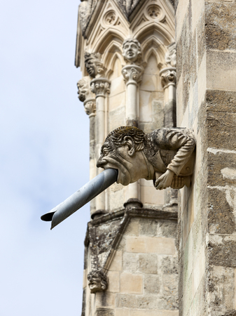 west sussex: Modern gargoyle on south face of Chichester Cathedral, Chichester, West Sussex, England Stock Photo