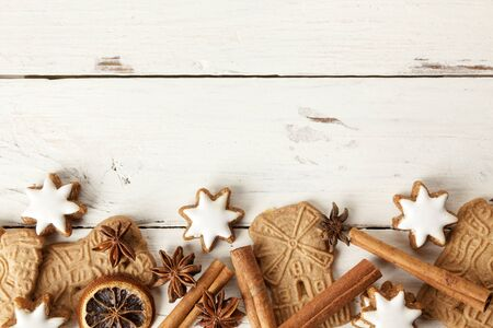speculaas: Christmas cookies and spices on wooden background, with copyspace