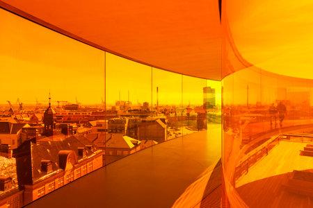 Aarhus, Denmark - May 2, 2017: View through orange tinted glass over Aarhus from inside Olafur Eliasson� � �,�� � s installation on top of Aarhus art museum