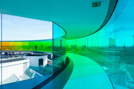 Aarhus, Denmark - May 2, 2017: Visitors inside installation by Danish-Icelandic artist Olafur Eliasson on top of ARoS art museum
