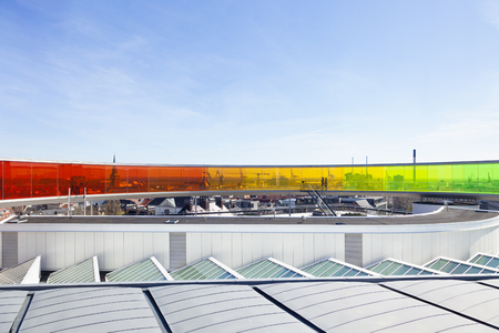 Aarhus, denmark - May 2, 2017: View over Aarhus through the rainbow color tinted installation by Olafur Eliasson on the rooftop of ARoS, the art museum Editorial