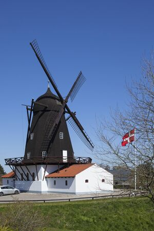 Historic windmill housing a museum at Grenaa on the Baltic Sea coast, Jutland, Denmark Stock Photo
