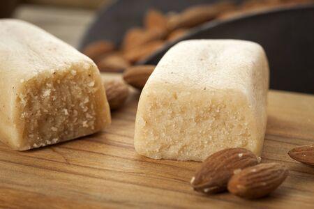 Marzipan bar in baking scene closeup with almonds Stockfoto