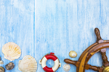 Seaside vacation background of blue weathered wood with border of maritime decoration