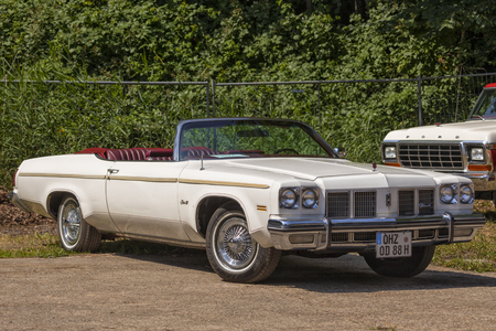 Stade, Germany - July 8, 2018: A vintage 1975 Oldsmobile Delta 88 Royale at 5th Summertime Drive US car meeting.