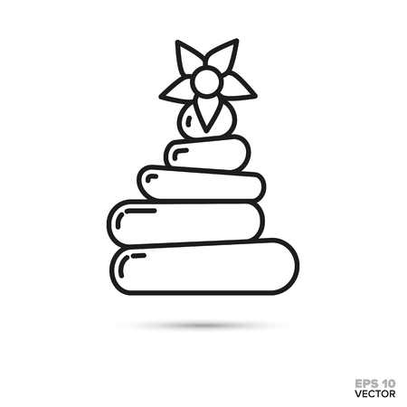 Blossom on stack of balanced pebbles. Spa, harmony and zen symbol.