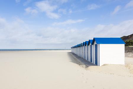 Row of white and blue beach huts at Boulogn-sur-Mer, Pas-de-Calais, France