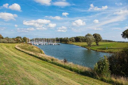 Marina on Hooksieler Binnentief lake at Hooksiel, Lower Saxony, Germany Stockfoto - 110762351
