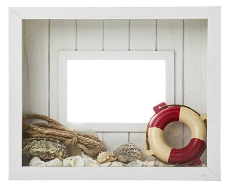 Wooden white picture frame with maritime decoration like sea shells, lifebelt and rope