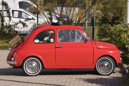 Stade, Germany - August 22, 2019: A red vintage FIAT 500 or Cinquecento in a parking lot.