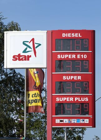 Stade, Germany - August 22, 2019: Star brand logo and price display at gas station. Star is a brand of PKN Orlen, a mineral oil company seated in Poland.