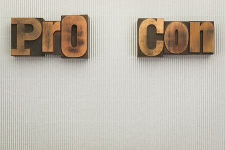 Pro and Con, words written with vintage letterpress type on textured silver background with copy space below