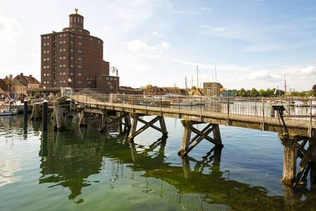 The historic warehouse called Rundsilo and the wooden drawbridge at the harbor of Eckernfoerde on the Baltic Sea coast