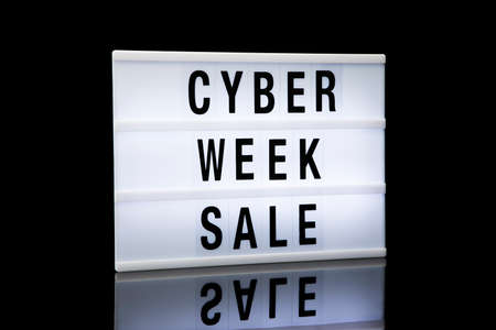 Cyber week sale signage. Lightbox with text on black background.
