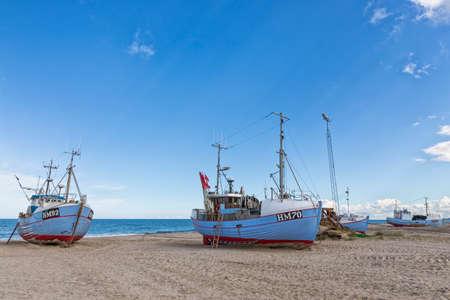Fishing boats towed to Thorup beach at Jammerbugt bay on the Danish North Sea coast