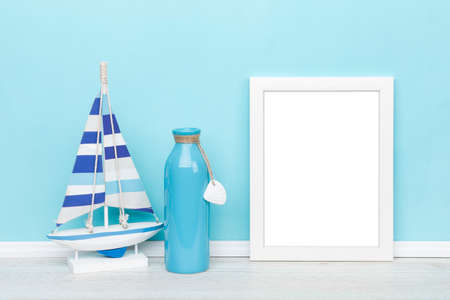 Maritime artwork background mockup  white picture frame, sail boat and vase in front of turquoise wall, image area isolated    for ease of use Stock fotó