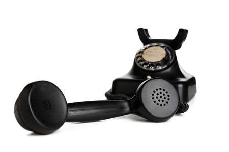 Vintage black telephone with receiver taken off the hook isolated on white background, selective focus 版權商用圖片