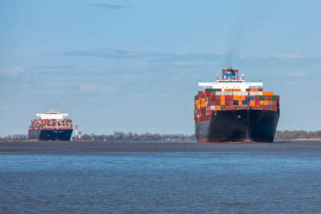 Two very large container ships on the Elbe river heading to Hamburg Reklamní fotografie