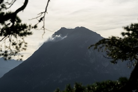 Mountain silhouette with forest and cloudy sky Stock fotó