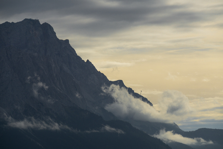 Highest mountain of germany with clouds rolling over it