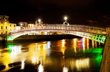 liffey: Famous Hapenny bridge over Liffey river in Dublin at night Stock Photo
