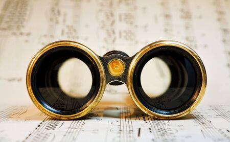 scores: Old theater binoculars over classical music scores.