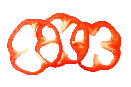 cut slices of red sweet bell pepper isolated on white background top view Banque d'images - 118686132