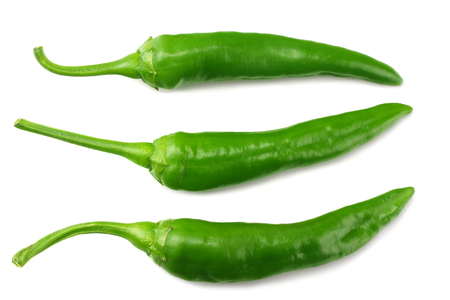 green hot chili peppers isolated on white background top view