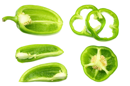 green sweet bell pepper with slices isolated on white background top view Stock fotó