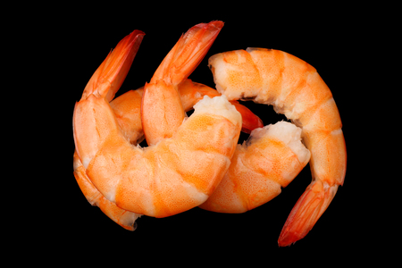 shrimps isolated on a black background. top view Stock Photo