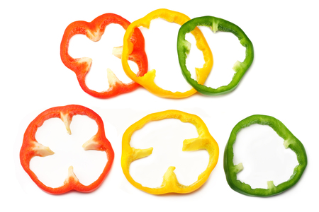 slices of sweet bell pepper isolated on white background top view