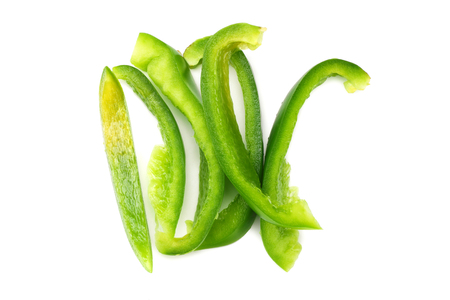 cut slices of green sweet bell pepper isolated on white background top view Banque d'images - 118685924
