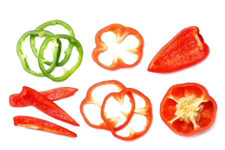 cut slices of red and green sweet bell pepper isolated on white background top view Banque d'images - 118686423