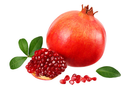 pomegranate fruit with seeds and green leaves isolated on white background Фото со стока